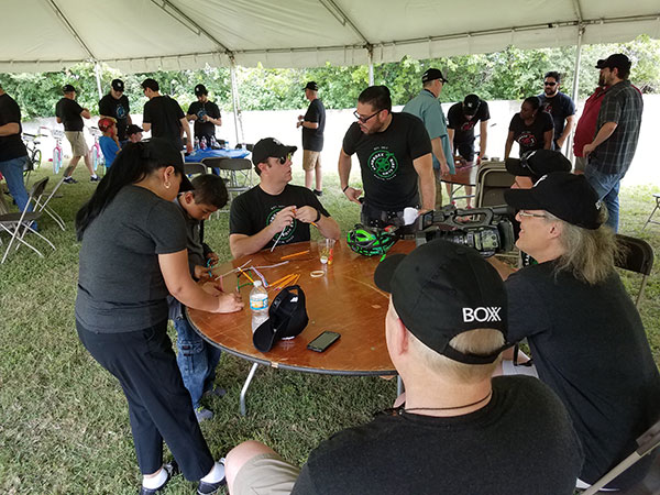 BOXX employees assembling bicycles in an outdoor tent