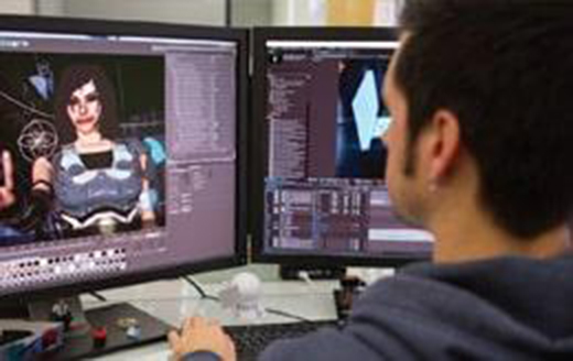 a man editing video in front of a dual monitor workstation