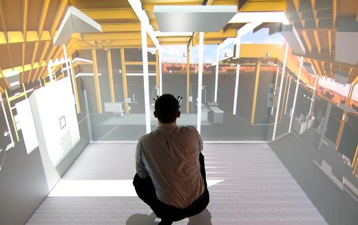A man squatting inside a Virtual Reality Visualization cube