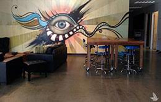 waiting room with mural of an eye on one wall