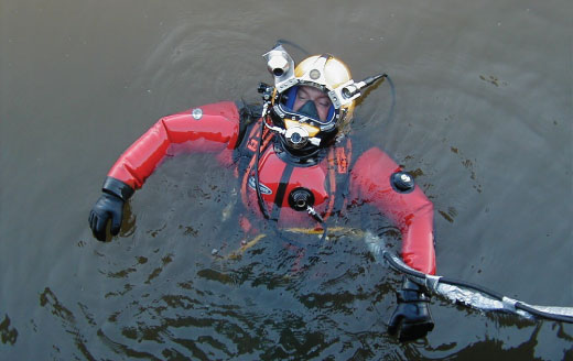 Brian Abbott floating on top of water in scuba diving gear