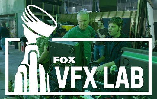 two men working at a computer on a film set, overlaid with the Fox VFX Lab Logo